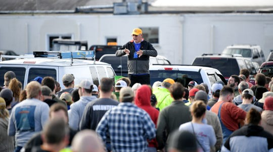 An official instructs volunteers in the cleanup effort before going out to the scene in Putnam County Wednesday, March 4, 2020, after a tornado touched down earlier in the week.