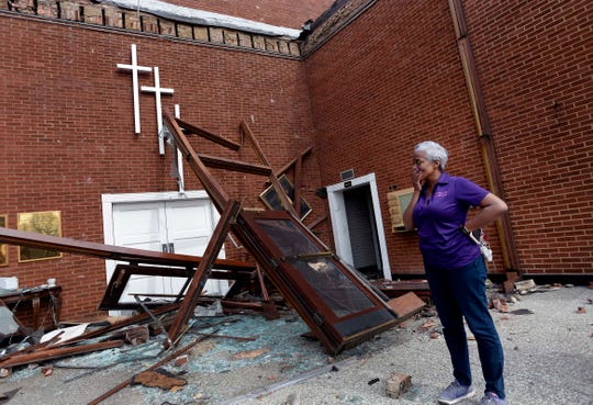 The Rev. Lisa Hammonds of the St. John A.M.E. Church fights back her emotions as she looks over the tornado damage to her church on Wednesday, March 4, 2020, in North Nashville, Tenn.