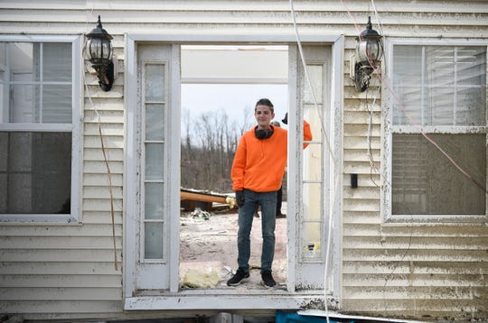 15-year-old Zach Hutchinson stands in the doorway of his family's home on Charlton Square in Baxter, Wednesday, March 4, 2020. A tornado hit the Cookeville area early morning Tuesday.