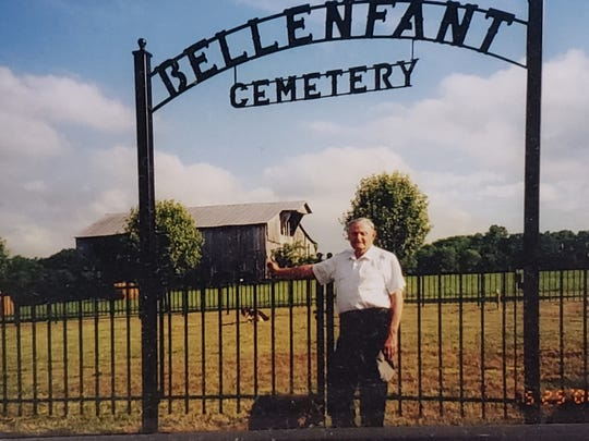 A family cemetery sits on DeLacy Bellenfant's property on Bellenfant Road, named for her family. Her family has had roots in Williamson County for 200 years, she said. Her late father Joe Bellenfant stands in front of the cemetery in 2000. He died in 2001.
