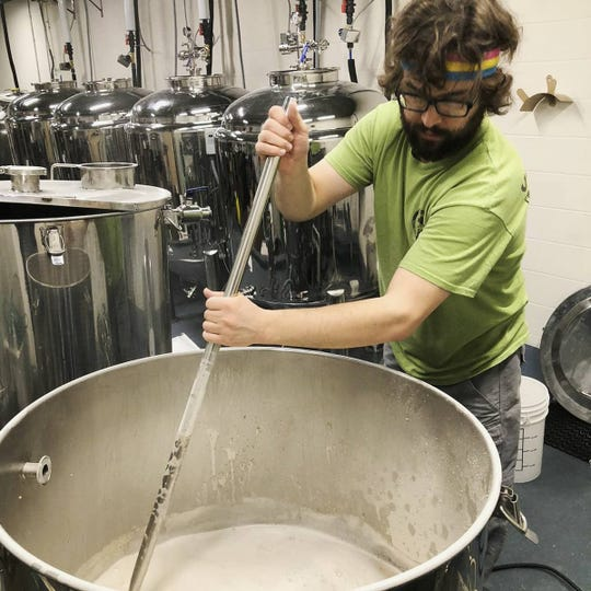 Grayson Miller brews his first batch of beer for Crazy Gnome Brewery on Sunday, two days before the tornado swept through East Nashville.