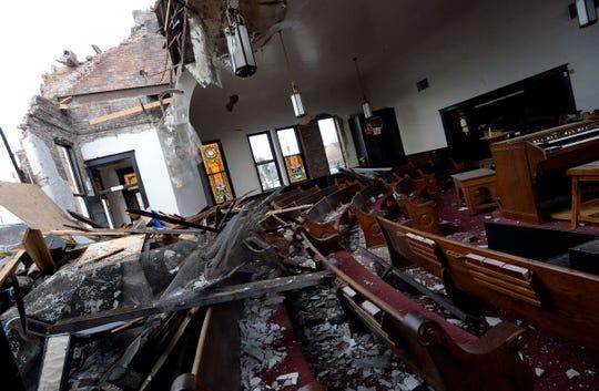 An inside look reveals extensive damage to Hopewell Baptist Church on Monroe Street.