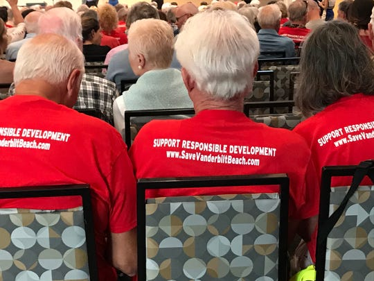 """Opponents of the One Naples project wore red T-shirts with the message """"Support Responsible Development"""" at a Neighborhood Information Meeting March 3, 2020."""