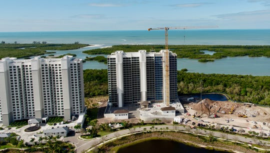 With Tower 200 at Kalea Bay (center) approaching sell out, construction has started on the high-rise community's third tower (right).