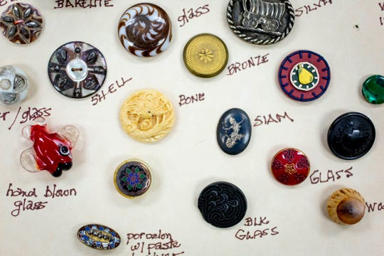 A selection of Carolyn Shaw's collection of buttons, which she labels in order to remember and learn more about them, photographed during a Gulf Breeze Button Club meeting at Golden Gate Community Center on Tuesday, March 3, 2020.