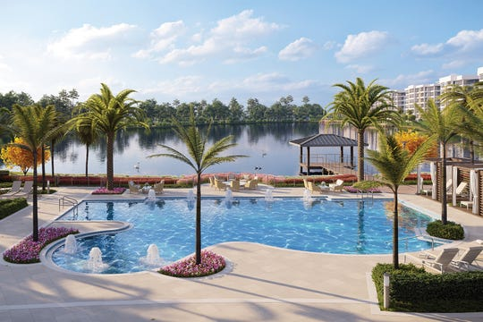 The Clubhouse at Moorings Park Grande Lake is the centerpiece of the community and includes a resort-style pool, cabanas and poolside Bistro.