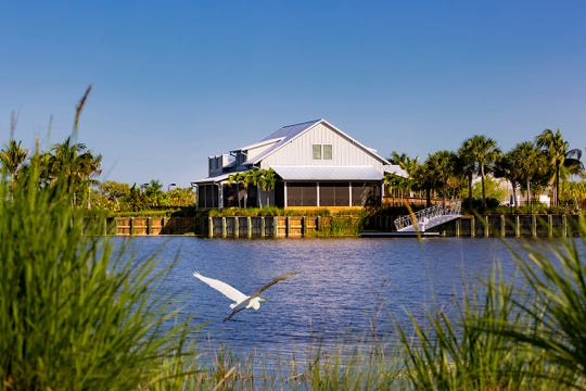 The private Overlook Bar & Grill at The Isles of Collier Preserve has the rustic feel of an Old Florida waterside bar.