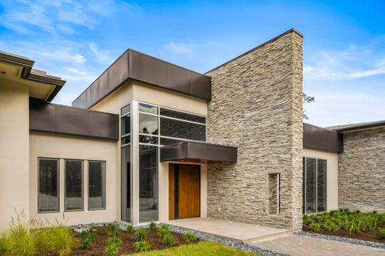 KTS Homes has completed its second custom built home in Naples Club Estates which features a modern contemporary design.