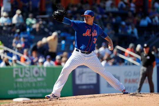 New York Mets pitcher Justin Wilson throws during the fifth inning of a spring training baseball game against the Washington Nationals Sunday, March 1, 2020, in Port St. Lucie, Fla.