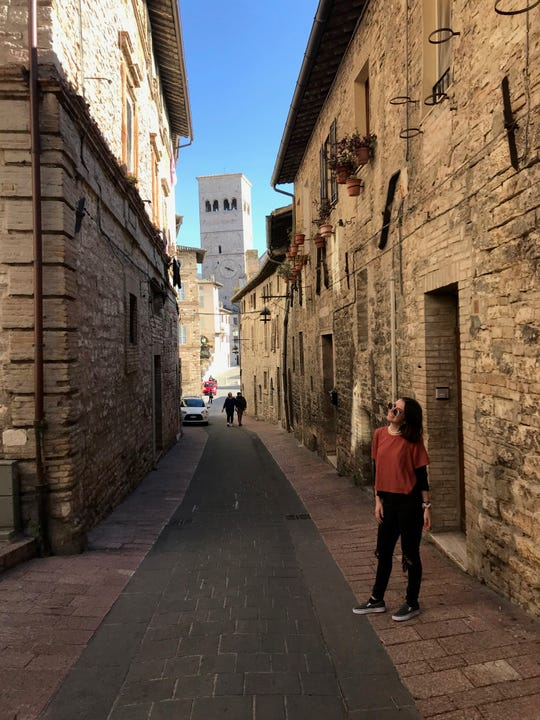 Sara Petrozziello, a junior journalism major at The College of New Jersey, shown in Assisi, Italy, during a study abroad trip in February. She had to return to New Jersey two months early due to the coronavirus outbreak.