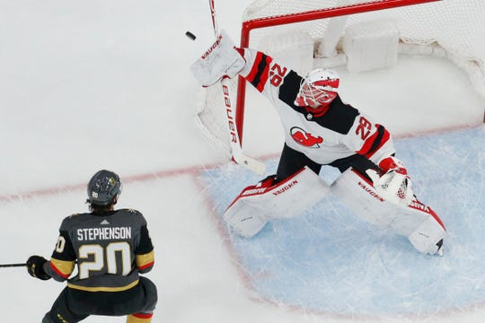 New Jersey Devils goaltender Mackenzie Blackwood (29) attempts to block a shot by Vegas Golden Knights center Chandler Stephenson (20) during the first period of an NHL hockey game Tuesday, March 3, 2020, in Las Vegas.