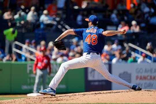 New York Mets pitcher Jacob deGrom throws during the second inning of a spring training baseball game against the Washington Nationals Sunday, March 1, 2020, in Port St. Lucie, Fla.