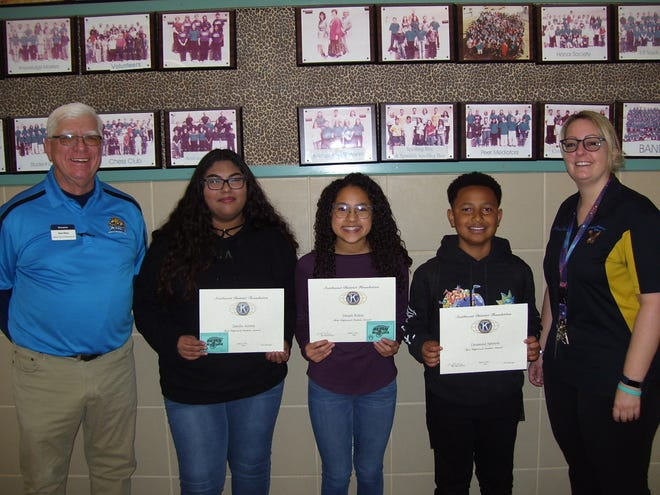 The Alamogordo Kiwanis Club is recognizing February's Most Improved Student of the Month. From left are Kiwanis Ned Kline, eighth grader Janelle Acosta, seventh Denali Rubio, sixth grader Desmond Spencer and Administrator Intern Cresta Hooser.