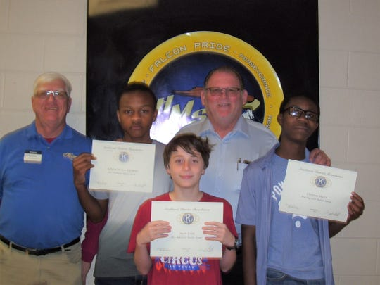 The Alamogordo Kiwanis Club is recognizing February's Most Improved Student of the Month. From left are Kiwanis Ned Kline, seventh grader Kriston Moorer-Alexander, sixth grader Jacob Little, Principal Dr. Joe Keith and eighth grader Christian Harris.