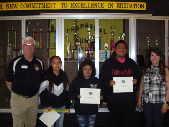 The Alamogordo Kiwanis Club is recognizing February's Most Improved Student of the Month at Chaparral. From left are Kiwanis Ned Kline,  sixth grader Jameka Herrera, seventh grader Sommer Sosa, eighth grader Demetrius Powell and Principal Cynthia Bond