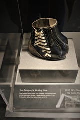 "A modified shoe worn by New Orleans Saints kicker Tom Dempsey when he booted a record-setting 63-yard field goal in 1970 is part of the ""Gridiron Glory"" exhibition."