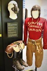 "The ""Gridiron Glory"" exhibition at the Farmington Museum at Gateway Park dives deep into the sports roots with displays of early equipment."