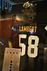 "A Jack Lambert jersey and a Mean Joe Green helmet are included in a Pittsburgh Steelers display in the ""Gridiron Glory"" exhibition at the Farmington Museum at Gateway Park."