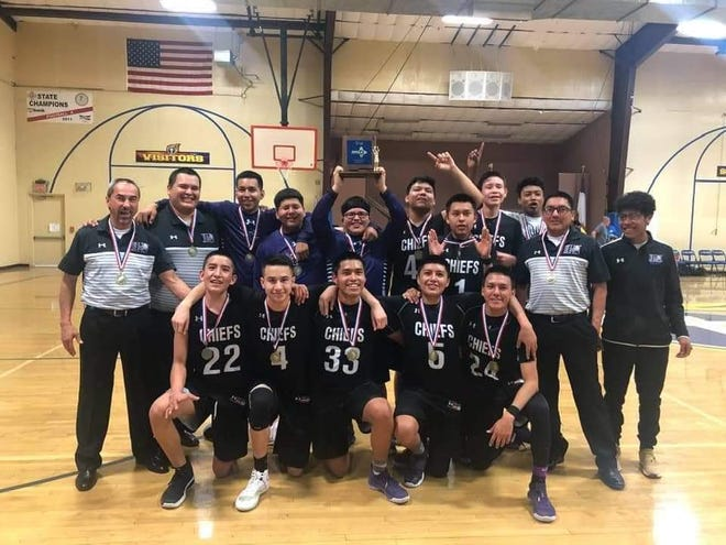 The Mescalero Chiefs pose after winning the Class 3-2A district championship against Mesilla Valley Christian School, 55-54 on Feb. 29, 2020. Mescalero is currently on a four-game winning streak and will travel to Santa Rosa on Saturday for a 7 p.m. first round game of the state tournament.