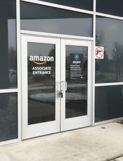 Amazon employees will start work at a Lyon distribution facility this month after the company obtained final approvals.