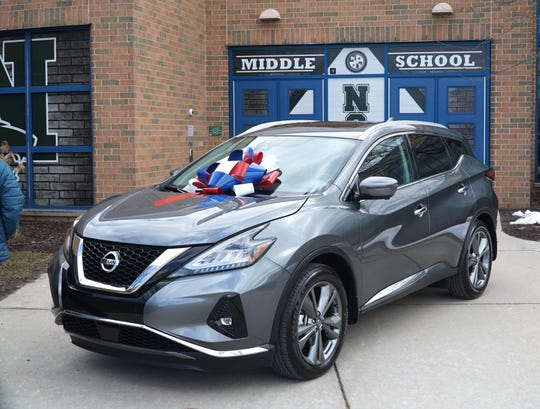 Novi Educational Foundation Teacher of the Year Brad Miller won a free lease for this Nissan crossover, or another vehicle from the dealership.