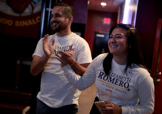 Volunteers for Elizabeth Romero for State Senate Julio Rodriguez, left, and Karena Heredia react as Romero speaks during at her election watch party at Mi Linda Sinaloa in Coachella, Calif., on Super Tuesday, March 3, 2020.