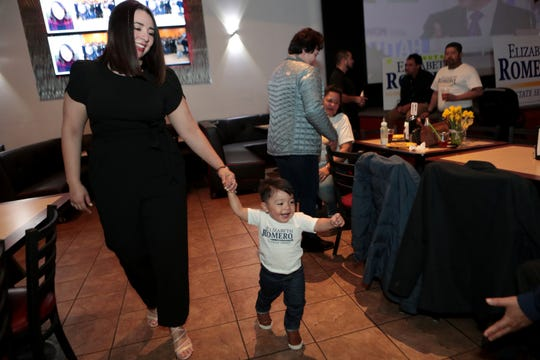 State Senate Candidate Elizabeth Romero walks with her 15-month-old son Aaron Eduardo during her election watch party at Mi Linda Sinaloa in Coachella, Calif., on Super Tuesday, March 3, 2020.