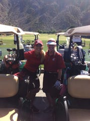 Pro golfer and Cougar alum Becky Fossum joins Shari Freidenrich, alum and emcee of Saturday's luncheon.