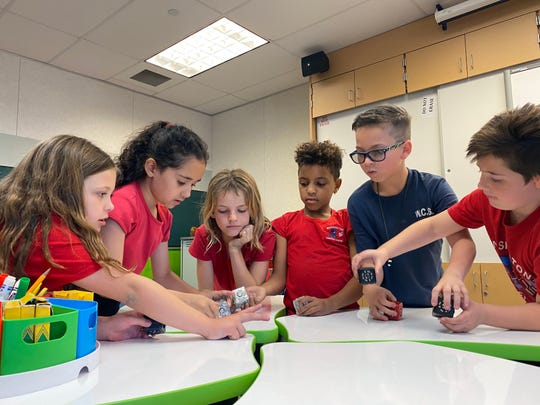 Students Sadie Karr, Gabriella Felix, Nora Capra, Sofia Capra, Richie McIntosh and Michael Sklar work on a cubelet project at Washington Charter school's STEM Lab. The public schools' fundraising gala will be held Saturday, March 21, 2020, at the Renaissance Indian Wells