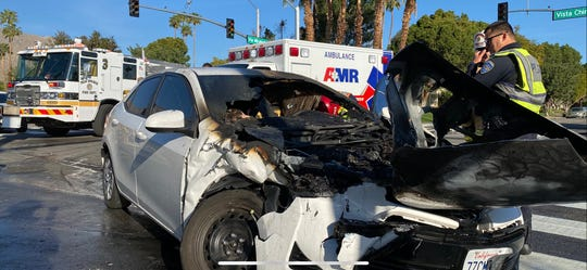 Authorities observe a car involved in a collision at Vista Chino and Via Miraleste in Palm Springs Wednesday, March 4, 2020. Six people