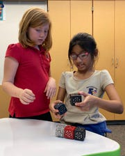 Second grade students Sloane Williams and Maimoona Moosa work on a project at Washington Charter school's STEM Lab.