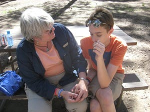 Always travel with a nurse. Lesley Hooser fixes Sawyer's injury while camping at the south rim of the Grand Canyon in 2011.