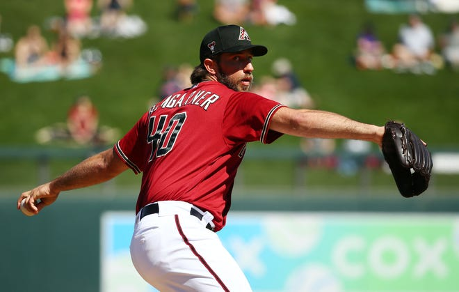 Arizona Diamondbacks pitcher Madison Bumgarner warms up before a start against the Cleveland Indians during a Cactus League game on March 4, 2020 at Salt River Fields.