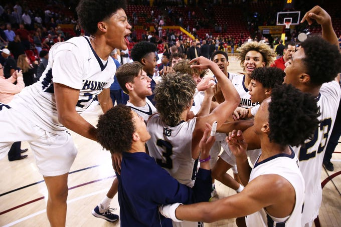 Desert Vista celebrates their victory over Mountain Pointe to win the 6A high school boys basketball championship on Mar. 3, 2020 in Tempe, Ariz.