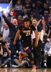 Mar 3, 2020; Phoenix, Arizona, USA; Phoenix Suns forward Cameron Johnson after hitting a three point shot against the Toronto Raptors in the second half at Talking Stick Resort Arena. Mandatory Credit: Mark J. Rebilas-USA TODAY Sports