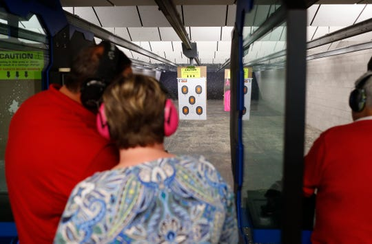 Customers fire inside the shooting range at the C2 Tactical in Phoenix, Ariz. on Feb. 23, 2020.