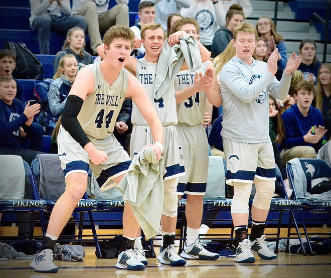 Marysville's bench celebrates a big play against St. Clair during a non-conference boys basketball game on Tuesday, March 3, 2020.