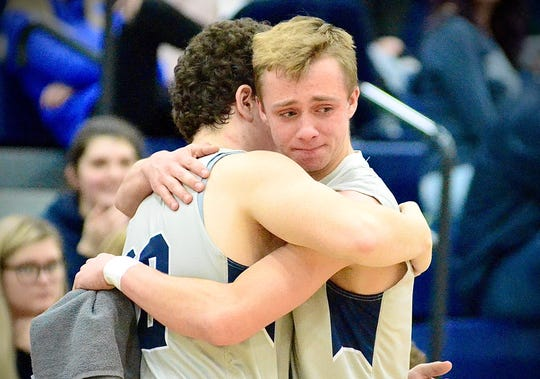 Marysville's Logan Wright gets a hug from Zach Meier during a non-conference boys basketball game on Tuesday, March 3, 2020.