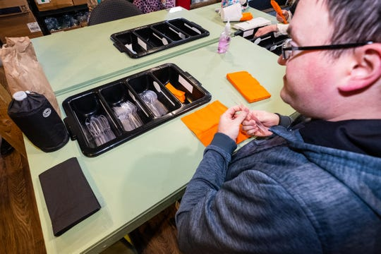 """Patrick Myers works on rolling plastic silverware at Simply Silverware Tuesday, March 3, 2020, in St. Clair. The business employs """"amazing individuals with special needs."""""""