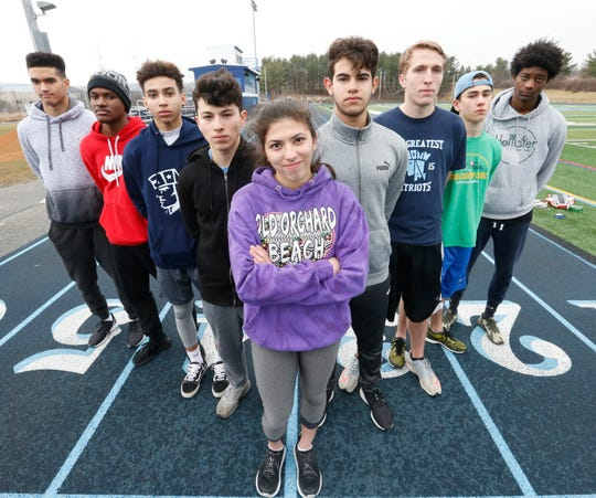Members of the John Jay winter track team who are heading to the New York State Championships, from left, Jonathan Mahon, Eric Amilcar, Kieran Allen, Matthew Conde, Elena Vargas, Matthew Reyes, Spencer Freeer, Patrick Cullen and Ja'Lil Reynolds on March 3, 2020.