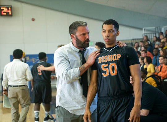 "Ben Affleck, left, and Brandon Wilson star in ""The Way Back."" The movie opens Friday at Regal West Manchester, Queensgate Movies 13 and Hanover Movies 16."