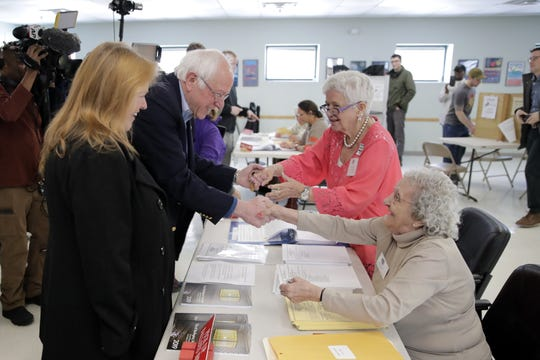 Democratic presidential candidate Sen. Bernie Sanders, I-Vt., and his wife Jane, arrive to vote in the Vermont Primary near his home in Burlington, Vt., Tuesday, March 3, 2020. (AP Photo/Charles Krupa)