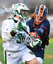 York College's Gunnar Reynolds, left, works to get the ball past Gettysburg's Nate Capriglione during mens lacrosse action at York College of Pennsylvania in Spring Garden Township, Wednesday, March 4, 2020. Gettysburg would win the game 7-6 in overtime. Dawn J. Sagert photo