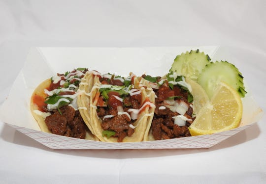 On the fusion tip, the chicken or beef tacos (shown here) from the Asian Street Eats food truck of Reno are flavored by taco spices and an Asian marinade.