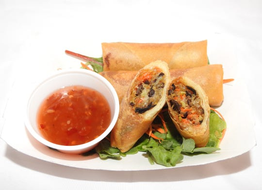 The Asian Street Eats food truck of Reno serves Laotian egg rolls in chicken or vegetarian versions, with a side of Laotian dipping sauce made from fish sauce, sugar, garlic, ground red chilis and palm sugar.