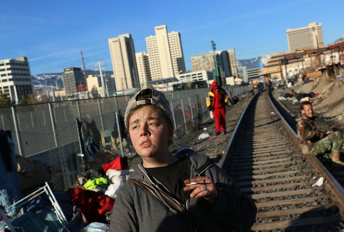 19 year old Moriah Stovall smokes a cigarette while getting evicted from a homeless encampment along the railroad tracks in Reno on March 4, 2020.