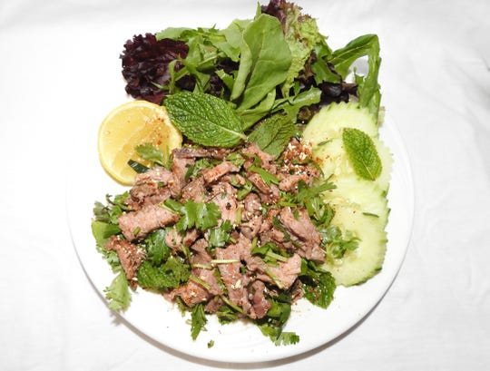 Laab (also known as larb), a popular meat salad, can be ordered with beef (shown here) or chicken from the Asian Street Eats food truck of Reno.
