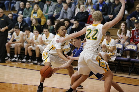 Kolden Vanlandingham (14) and Payton Lumpkin (22) trap an Eastern Hancock opponent during Northeastern's Class 2A sectional 41 win on Tuesday, March 3, 2020.