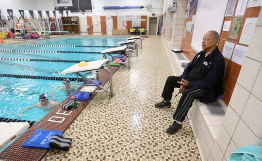 Marty Keating watches a swim practice at Pittsford Mendon's pool. Keating has coached the Pittsford girls swimming team since 1974 and serves as an assistant for the boys team. Both have won 18 straight championships.