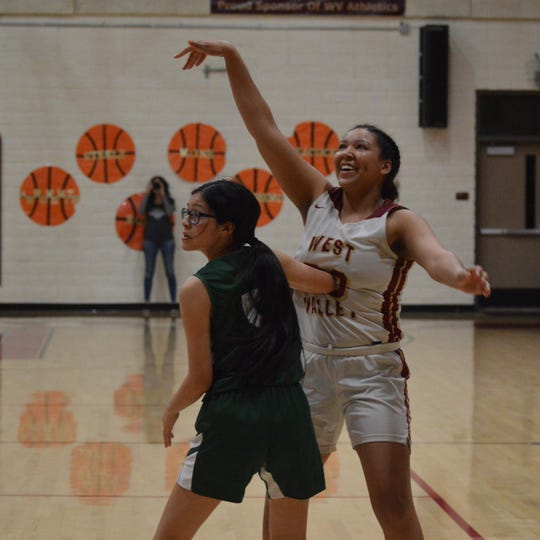 West Valley senior Rose Matthews smiles after watching her 3-point attempt swish through the hoop during the CIF Northern Regional first round matchup in Cottonwood on March 3, 2020.